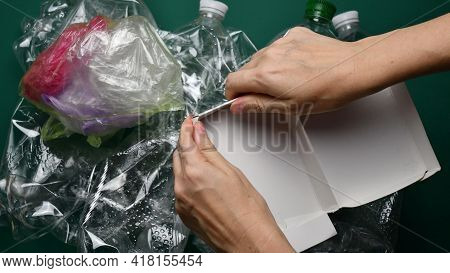 Female Hands Tear Cardboard Box Before Sorting Waste For Recycling. Pov Preparation Of Trash. Enviro