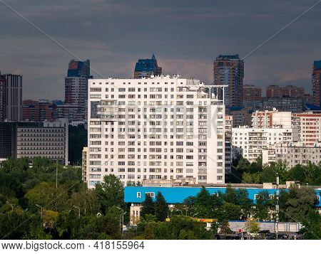 A Residential Skyscraper In Moscow Is Illuminated By The Sun After A Thunderstorm. District With Hig