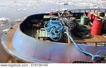 Part Of The Stern Of The Tug With Different Ropes And A Barrel Against The Background Of The Severna