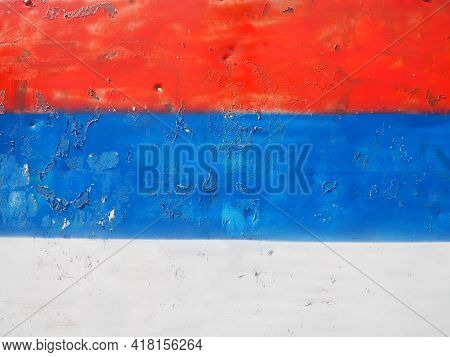 Serbian Flag, Tricolor Red, Blue, White Painted On A Metal Surface. Peeling Paint.