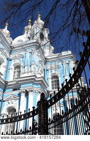 Orthodox Churches In Russia. Smolny Cathedral In St. Petersburg. Snow-white Church Domes With Orthod