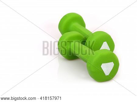 Green Dumbbells For Sports Activities Isolated On White Background