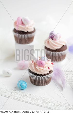 Three Easter Chocolate Cupcakes With Caramel Filling And Decoration Of Small Easter Eggs From Marzip