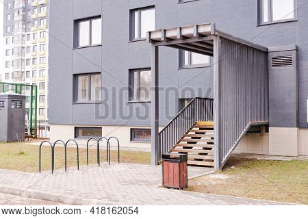 Entrance To A New Apartment Building. Entrance With Bicycle Parking And Urn. Entrance To The House B