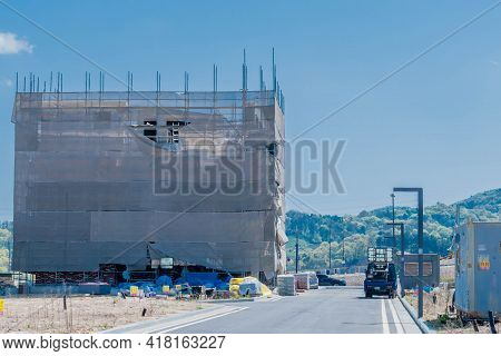 Daejeon, South Korea; April 18, 2021: New Building Raped In Mesh Tarps At Construction Site In Rural