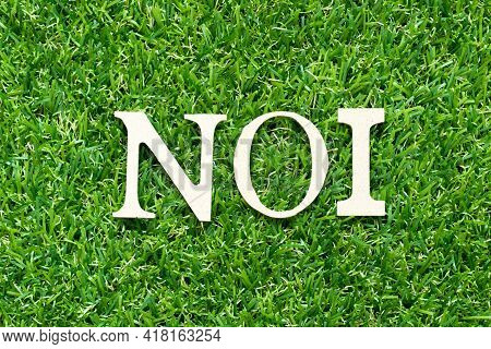 Alphabet Letter In Word Noi (abbreviation Of Net Operating Income Or Not Otherwise Indexed) On Green
