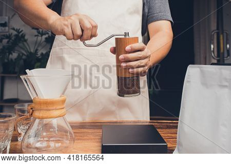 Person Holding Coffee Hand Grinder Manual Make Coffee At Home. The Process Of Making Drip Coffee.