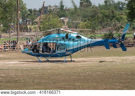Kandra, West Bengal, India - April 19, 2021; A Helicopter Is Landed In A Rural Area In India And The