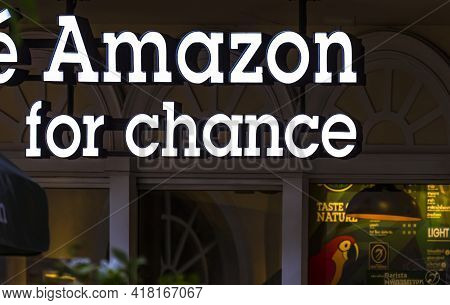Bangkok, Thailand - April 14,2021 : Illuminate Lighting Cafe Amazon For Chance Hanging Sign In Front