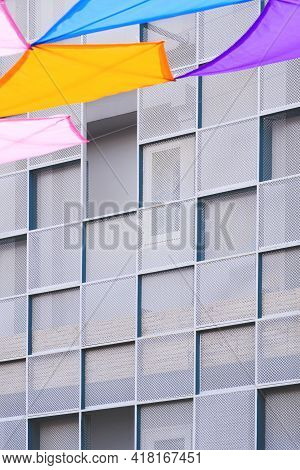 Perspective Side View Modern Steel Wall In Square Pattern With Blurred Colorful Decorative Fabric Ha