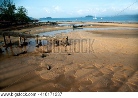 Beautiful Seascape With Destroyed Sea Bridge. Morning Beach View And Foreground Of Destroyed Quay In