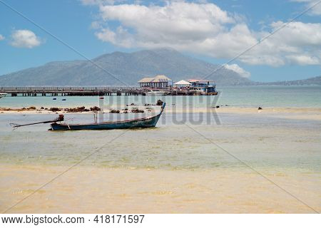 Tropical Beach Scenery With Longtail Boats In The Sea, Blue Sky And White Clouds In Summer And With