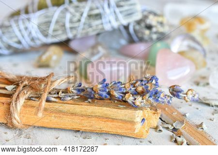 A Close Up Image Of Palo Santo Incense Sticks With Dried Lavender And Healing Crystals On A White Ba