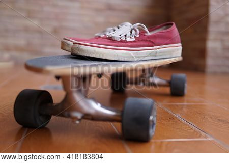 Surfskate Board With Red Skate Shoes As For Extreme Sport Background.