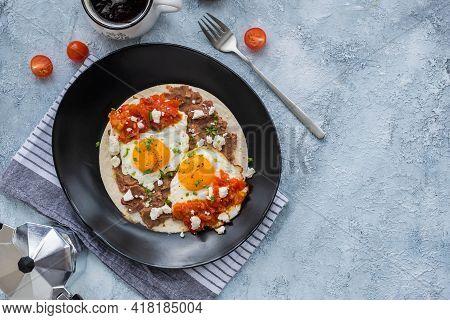 Huevos Rancheros, Mexican Fried Egg On A Wheat Tortilla With Tomato Salsa, Bean Paste And Feta Chees