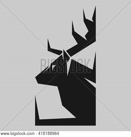 Abstract Deer Head Silhouette In Profile Portrait Symbol On Gray Backdrop. Design Element