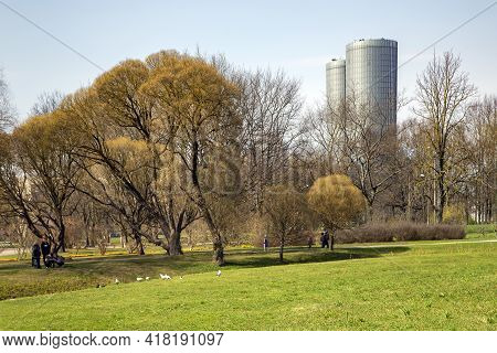 Latvia, Riga, April, 2021 - Families With Children Relax On Green Lawns In The Spring Victory Park I