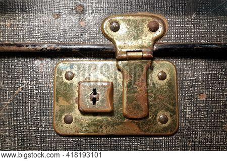 Old Rusty Vintage Suitcase Lock. Metal Detail Close Up. Locking Mechanism On Retro Suitcase
