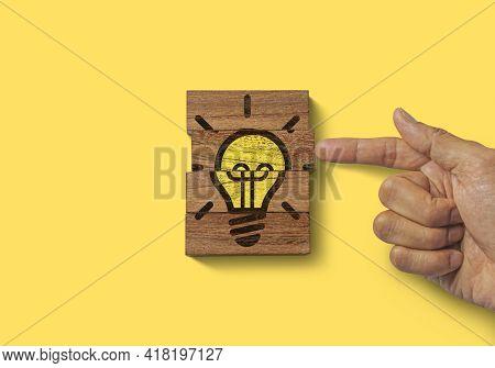 Creative Idea, Innovative Idea, Brainstorming Or Enlightenment Concept. Hand Putting The Last Piece