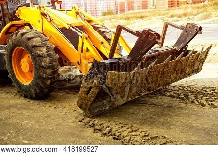 The Bulldozer Moves And Spreads The Soil And Rubble On The Embankment Of The Road.bulldozer Working