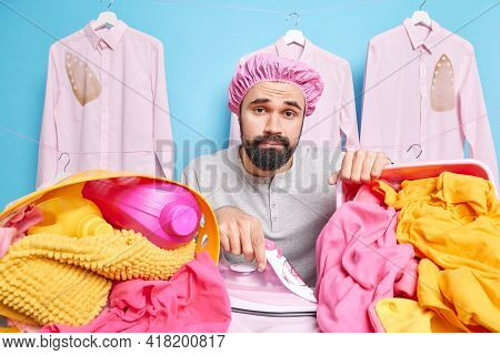 Serious Calm Man With Beard Busy Ironing Laundry Uses Electric Iron Wears Bath Hat Has Much Work Dur