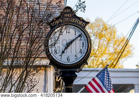 Close Up Isolated Image Of A Stand Alone Vintage Clock In The Town Center Of Oxford Maryland. It Say