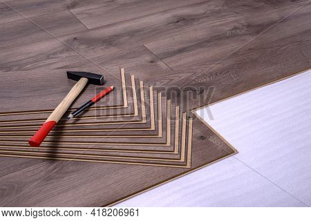 Hammer And Pencil On Laminate Panels, Carpenter Tools For Laying Laminate In The Room.
