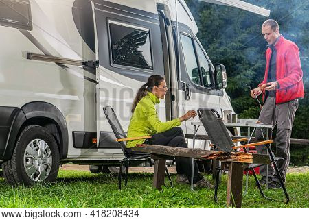 Caucasian Couple During Their Vacation. Modern Recreational Vehicle Rv Camper Van Road Trip With Cam
