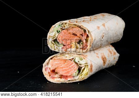 Seafood Shawarma. Grilled Cheesy Gyros Roll With Roasted Salmon Fish Fillet In Thin Lavash Bread. St