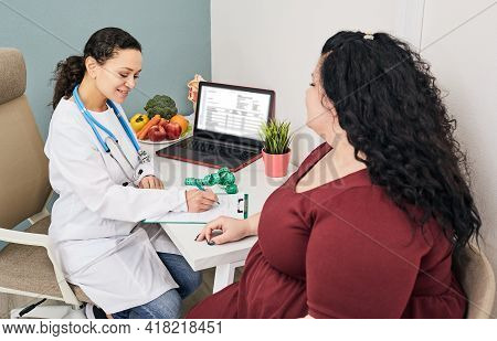 Obesity, Unhealthy Weight. Nutritionist Calculating Body Mass Index Of Fat Woman For Obesity Treatme