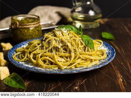 Homemade Pasta, Spaghetti With Pesto On A Vintage Painted Plate, Decorated With Basil And Parmesan L