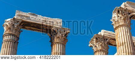 Ancient Temple Of Olympian Zeus, Athens, Greece. Panoramic View Of Corinthian Columns On Blue Sky Ba