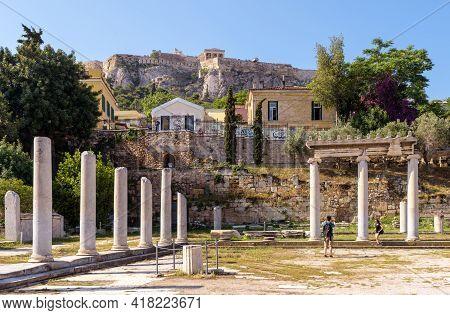 Athens - May 9, 2018: Tourist Visit Roman Agora In Athens, Greece, Europe. Famous Acropolis In Dista