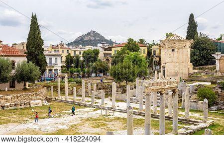Athens - May 6, 2018: Tourists Visit Roman Agora In Athens, Greece. Panorama Of Ancient Greek Ruins