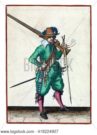 A soldier, full-length, to the right, with a musket (a type of firearm) resting on his left shoulder. In his left hand, in addition to the butt of the musket, also a burning fuse and a furket