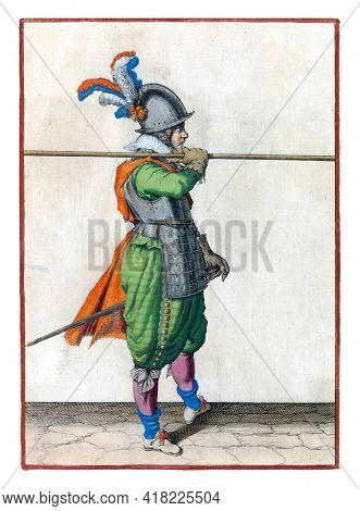 A soldier, full-length, to the right, carrying a spear (lance) horizontally on his right shoulder. His right hand on the skewer