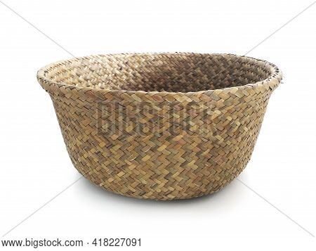 Frontal View Of Braided Storage Basket Isolated. Close Up Of Old Plaited Empty Round Wicker Basket.