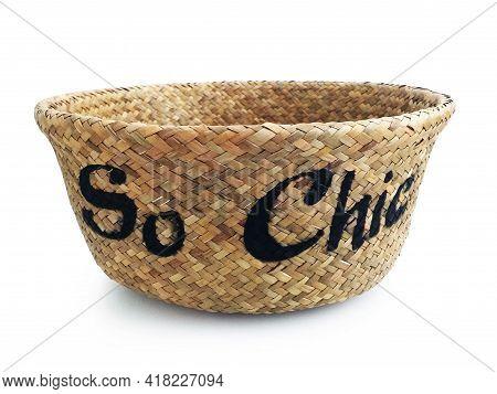 Close Up Of Old Plaited Empty Wicker Basket. Handmade Natural Fiber Basket On White Background. Brai