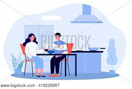 Happy Couple Having Breakfast Together. Boyfriend And Girlfriend Chatting At Table In Kitchen Flat V