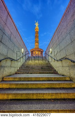 The Victory Column In Berlin At Night Seen From An Underpass