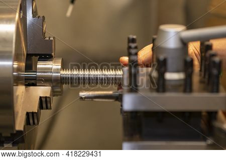 The Operation Of Turning Machine Cutting The Ball Screw Shaft Part. The Operation Of Lathe Machine C