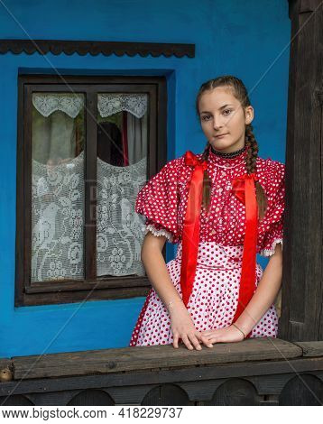 Salaj, Transylvania, Romania-may 14, 2018: Beautiful Young Girl In Traditional Costume Sitting On Th