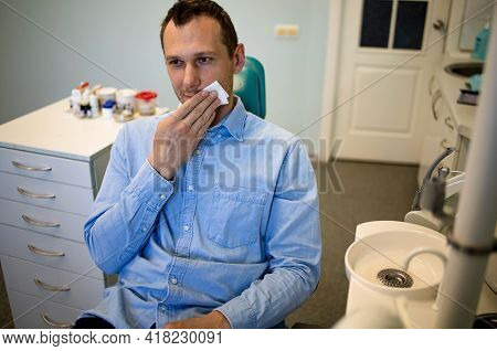 Fear Of Dentists. Phobia Dentist, Patient In The Dental Office. The Young Guy Feels The Fear Of The