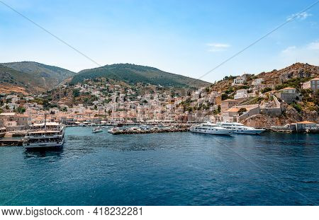 Hydra, Greece - April 29 2018: View Of The Crescent-shaped Port And The Village. Hydra Is A Small Pi