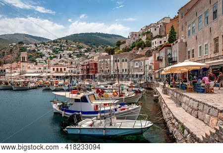 Hydra, Greece - April 29 2018: The Waterfront Of Hydra, With Shops, Galleries, Outdoor Restaurants A