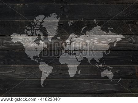 World Map Isolated On Black Wooden Wall Background