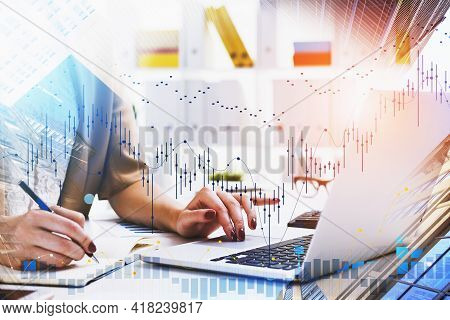 Businesswoman Or Stock Trader Analyzing Stock Market Graph Chart, Side View Business Woman Using Lap