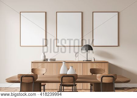 Office Room Interior With Three White Empty Posters In A Row On Beige Wall, Table With Six Chairs, O