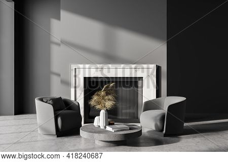 Dark Living Room Interior With Two Grey Armchairs And Marble Fireplace, Grey Concrete Floor. Mockup