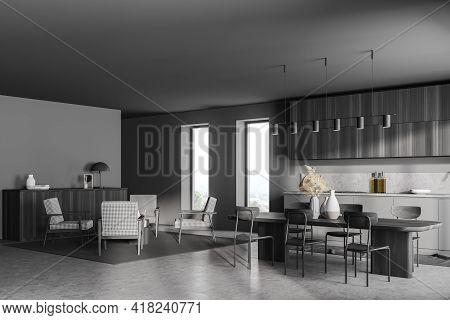 Stylish Modern Interior Of Dark Grey Modern Kitchen Room With Dining Table. Armchair Livingroom Zone